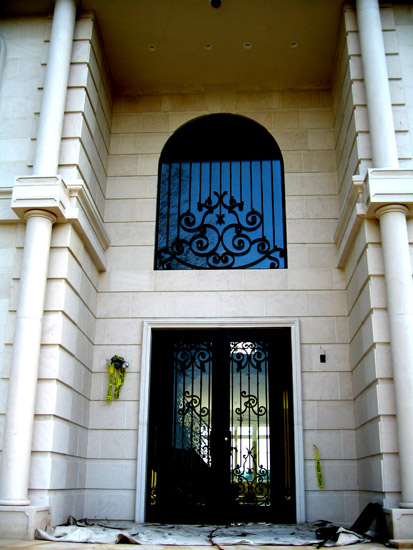 Iron Entry with Arched Window